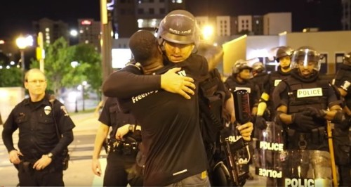 A protester in Charlotte gave out free hugs to police in riot gear — and they were incredibly grateful