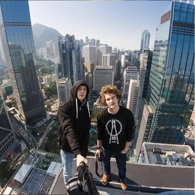 27 terrifying photos of 2 Instagram stars who risk their lives climbing landmark buildings around the world