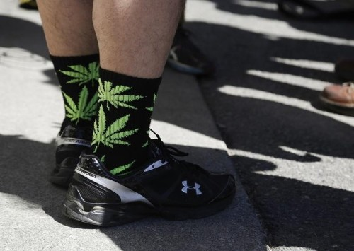 Washington state pulled down $65 million in first-year tax revenue from marijuana