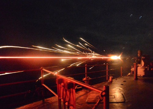 Take a look at these incredibly surreal photos of the Navy at night