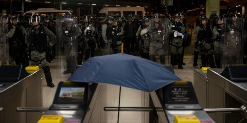 Masked assailants storm Hong Kong metro station with batons and reportedly attack pro-democracy protesters