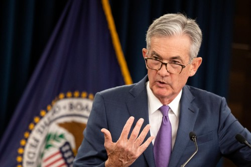 Trump lashes out as Powell signals the central bank won't cut rates as much as White House wants
