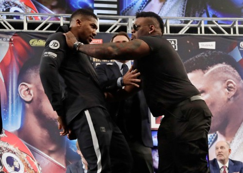 Jerrell Miller shoved Anthony Joshua so hard he almost fell over because the Brit was smiling