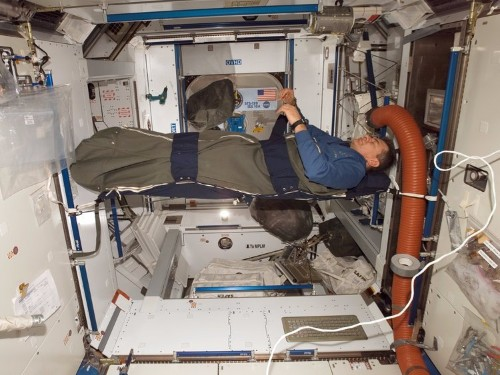 Astronauts sleep in padded broom closets and velcro their heads to pillows