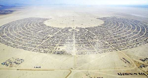 There's a smart reason why the Burning Man festival is laid out like a giant clock