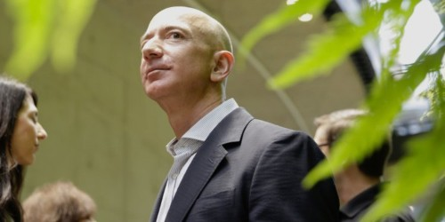 Amazon shareholder meeting swarmed by protestors in colorful outfits