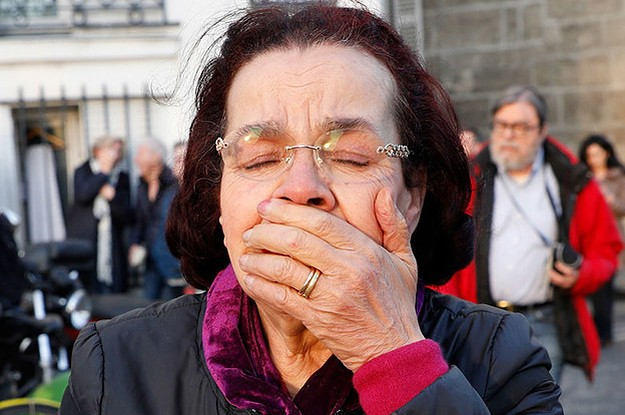These Heartbreaking Photos Show People Reacting To The Fire At Notre Dame Cathedral