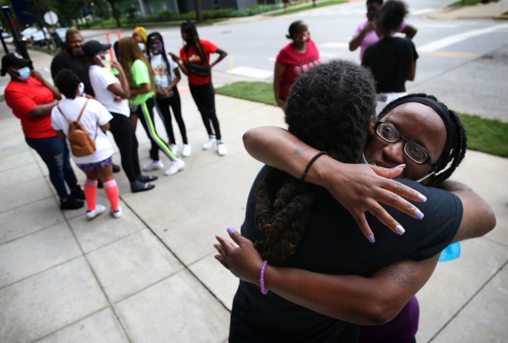 Her son was waiting to get into the police academy when he was shot in the head at a block party, but mom holds out hope for him and the city. 'Chicago can get better.'
