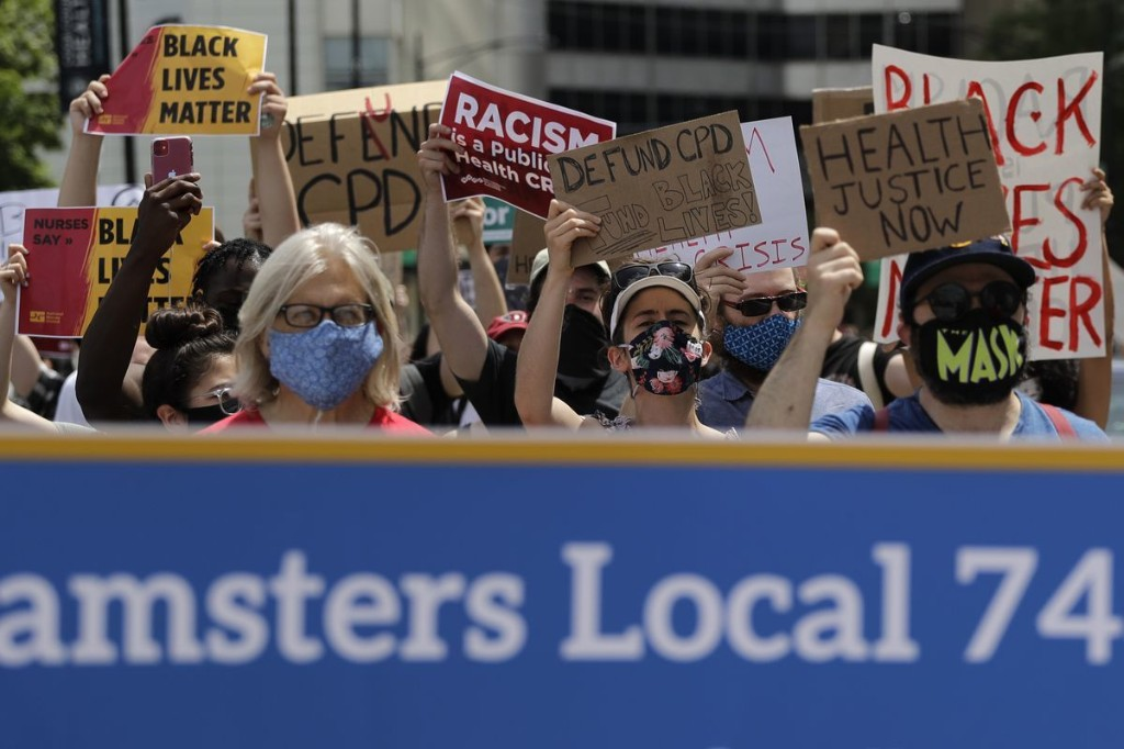 Health care workers demand racial justice during march through Chicago's Medical District: 'People are dying all the time because of their race'