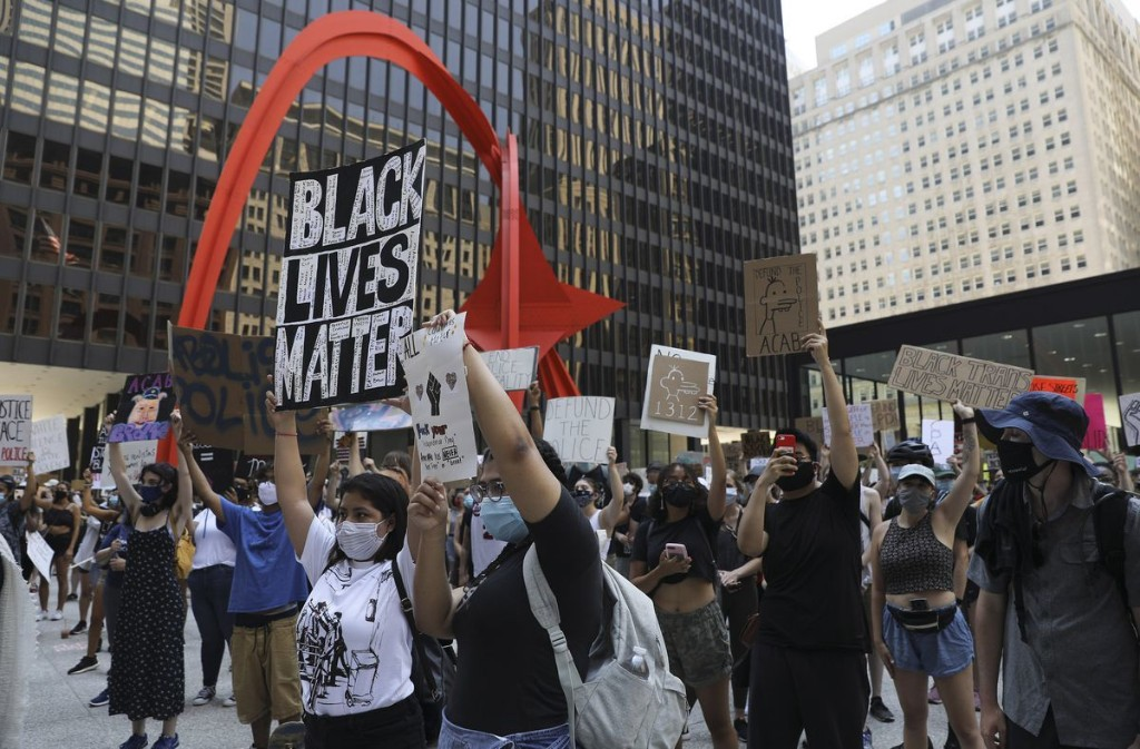 Protesters rally downtown for July Fourth boycott: 'That flag is a lie'