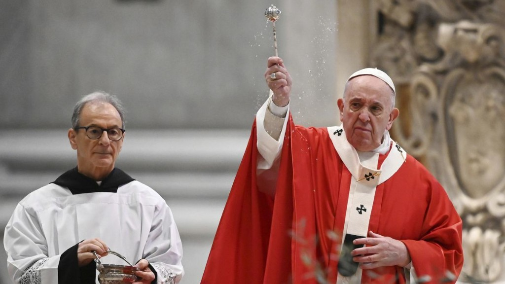 Pope Francis celebrates Palm Sunday Mass without the public at St. Peter's, urges people to 'reach out to those who are suffering'