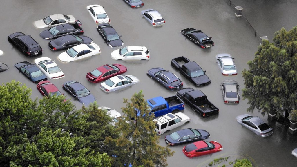 After hurricanes, flood of storm-damaged cars heading for market
