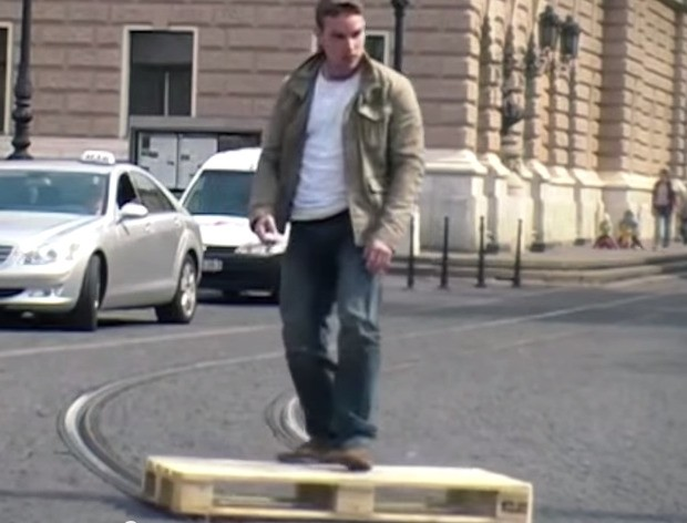 Think You Can Shred? Try Skateboarding a Pallet Down Tram Tracks