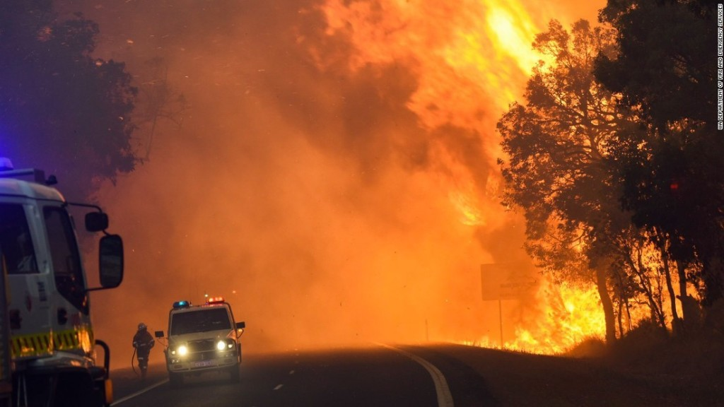 Raging fire consumes small Australian town - CNN