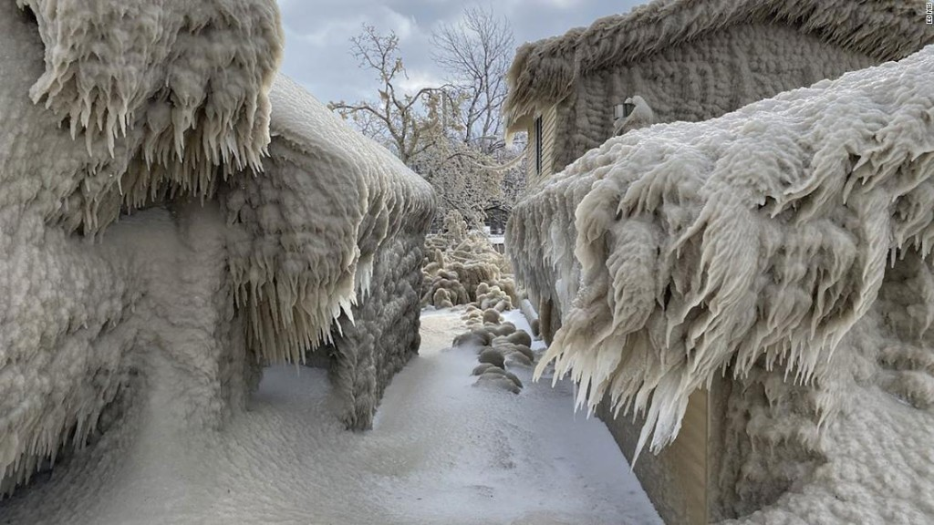 Homes along Lake Erie are covered in ice following two days of gale-force winds