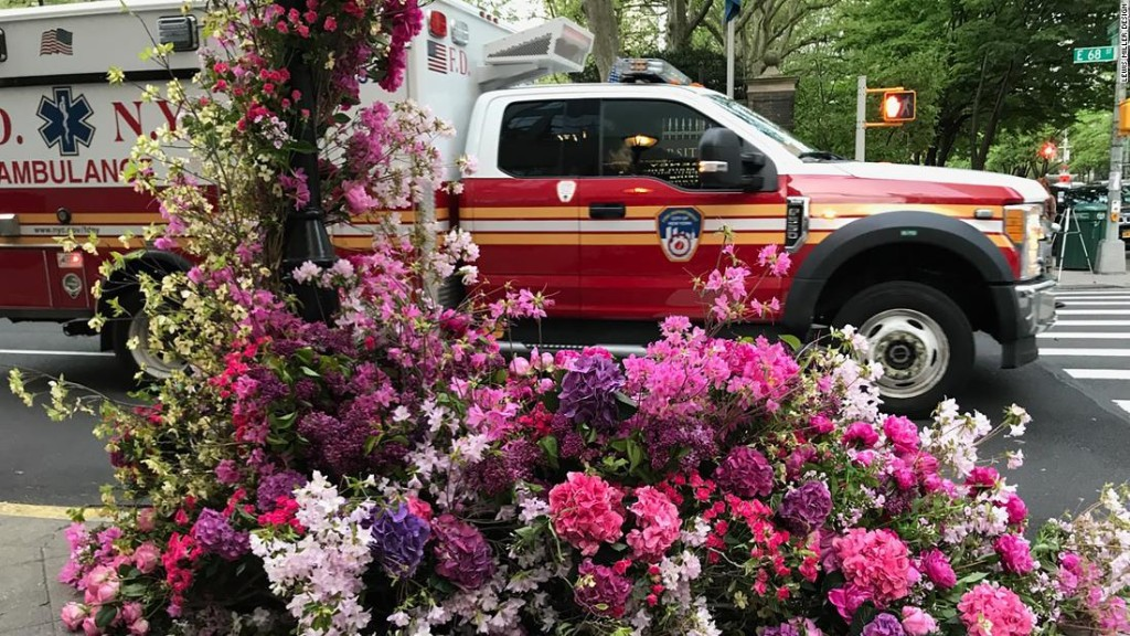 A floral designer is beautifying the streets of New York with elaborate displays for health care workers
