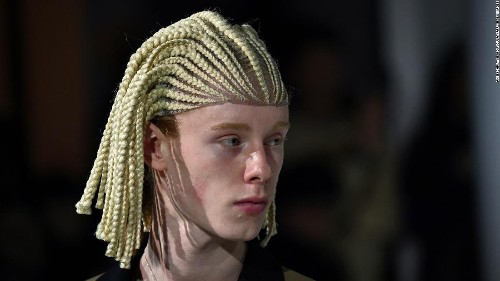 Comme des Garçons criticized for cultural appropriation for using lace front cornrow wigs