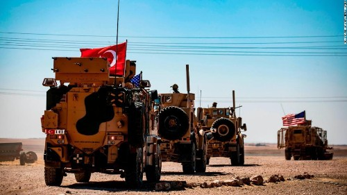 US and Turkish troops conduct first joint ground patrol of Syrian 'safe zone'