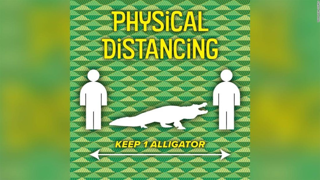 A Florida county is reminding people to maintain a distance of at least one alligator between each other