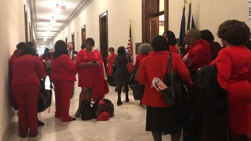 Dressed in red, Delta Sigma Theta sorority members blanket Capitol Hill