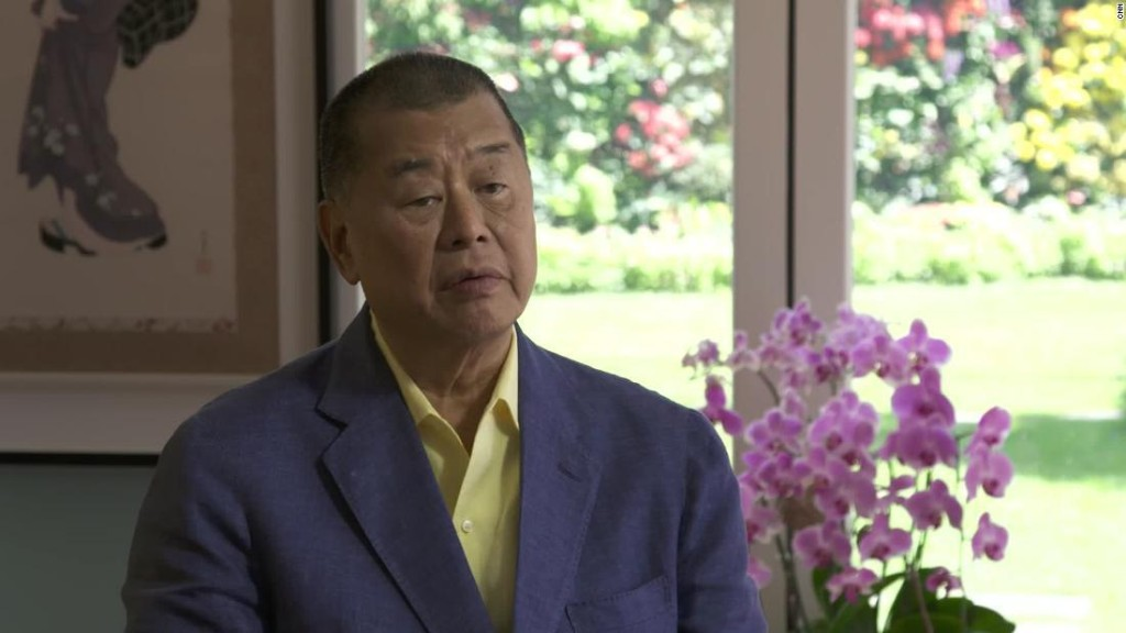 Hong Kong media tycoon says his arrest is a 'symbolic exercise'