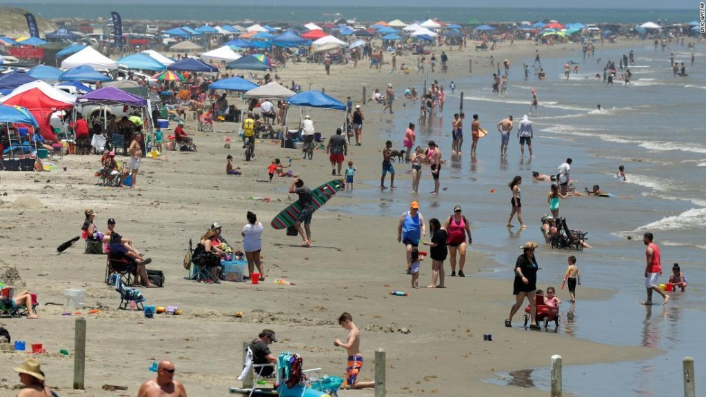 Some Americans take a holiday from social distancing and officials fear future spikes in coronavirus cases