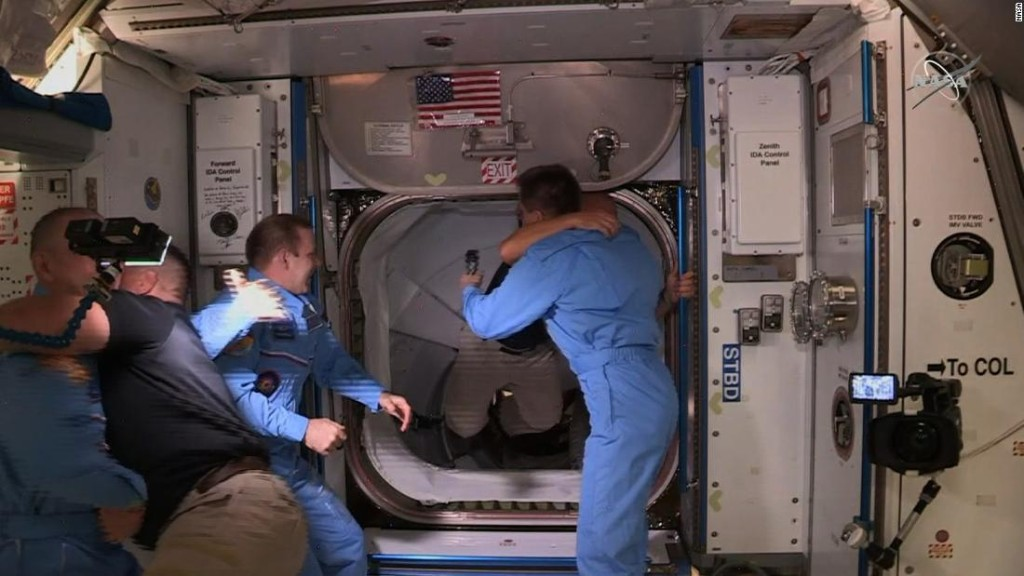 US astronauts disembark SpaceX's Crew Dragon and board the International Space Station