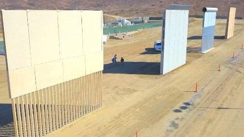 5 opinions from in the shadows of Trump's border wall prototypes