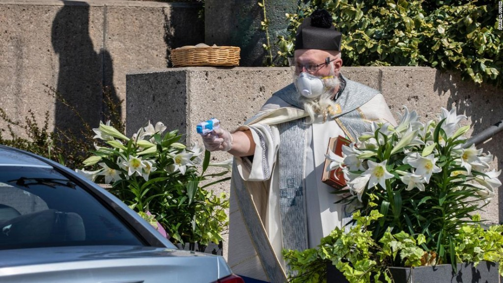 A priest fired holy water through a squirt gun at his congregants. Weeks later, he's gone viral