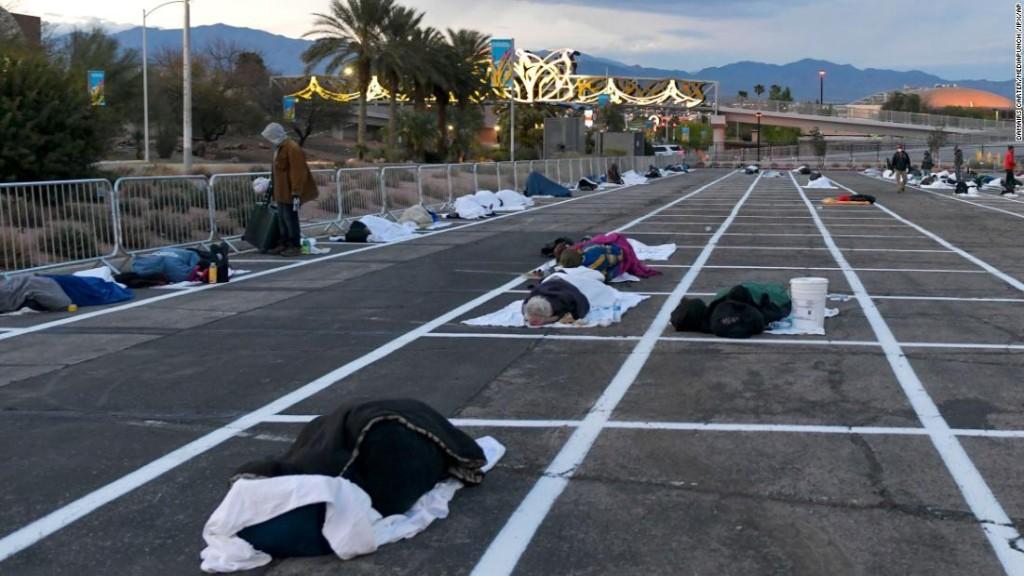 Las Vegas homeless people are sleeping in a parking lot -- six feet apart