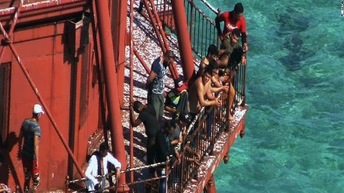 Lighthouse Cuban migrants climbed isn't 'dry land,' judge rules