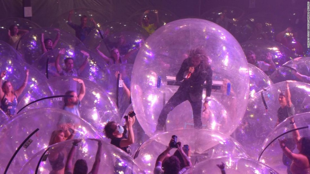 The Flaming Lips performed a concert with the band and fans encased in plastic bubbles