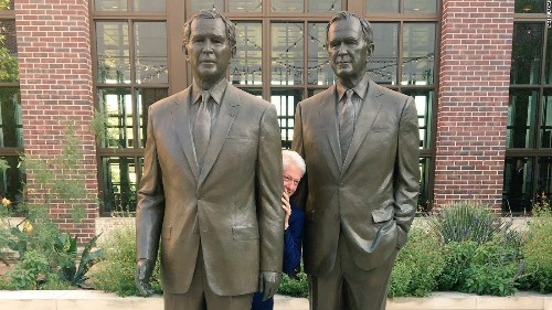 Bill Clinton is literally hiding between two Bushes in a viral photo