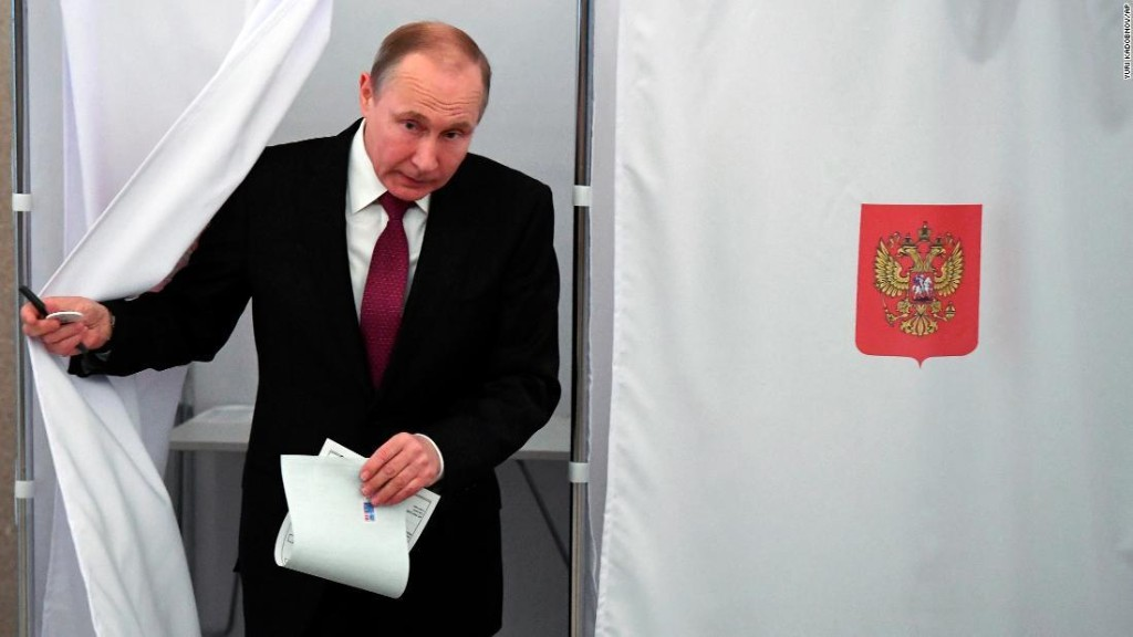 Vladimir Putin retains grip on Russia, exit polls show