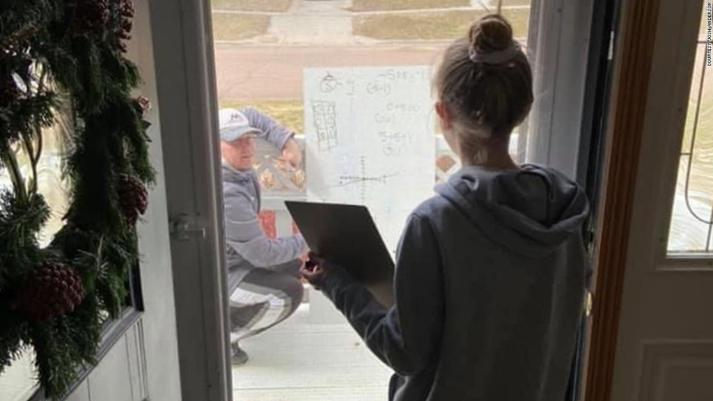 Math teacher shows up at student's front porch to give her a one-on-one lesson while social distancing