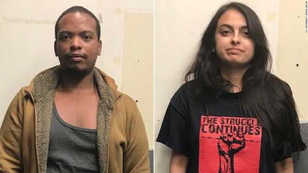 Two New York lawyers are in custody in connection with a Molotov cocktail attack on a police patrol car during weekend protests