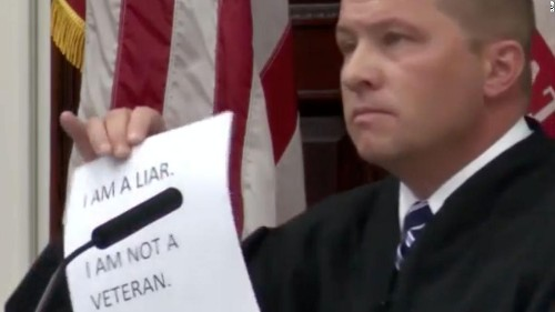 They falsely claimed to be military veterans, so a judge ordered them to write the names of more than 6,700 Americans killed in Iraq, Afghanistan