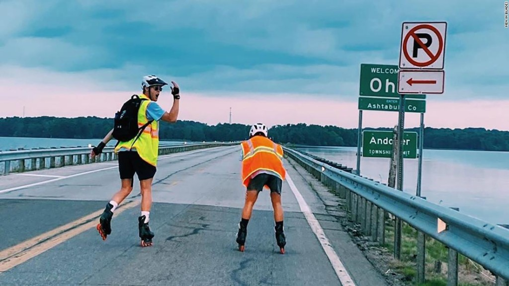 Two college hockey players rode roller blades nearly 900 miles from Boston to Michigan to raise money for cancer research
