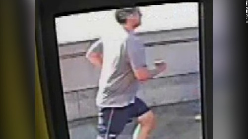 Police hunt man who knocked woman in front of London bus