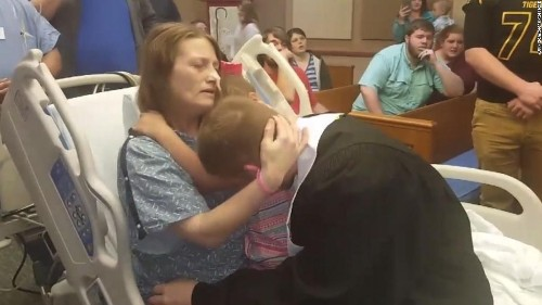 A mom with terminal cancer sees her son graduate in a special hospital ceremony