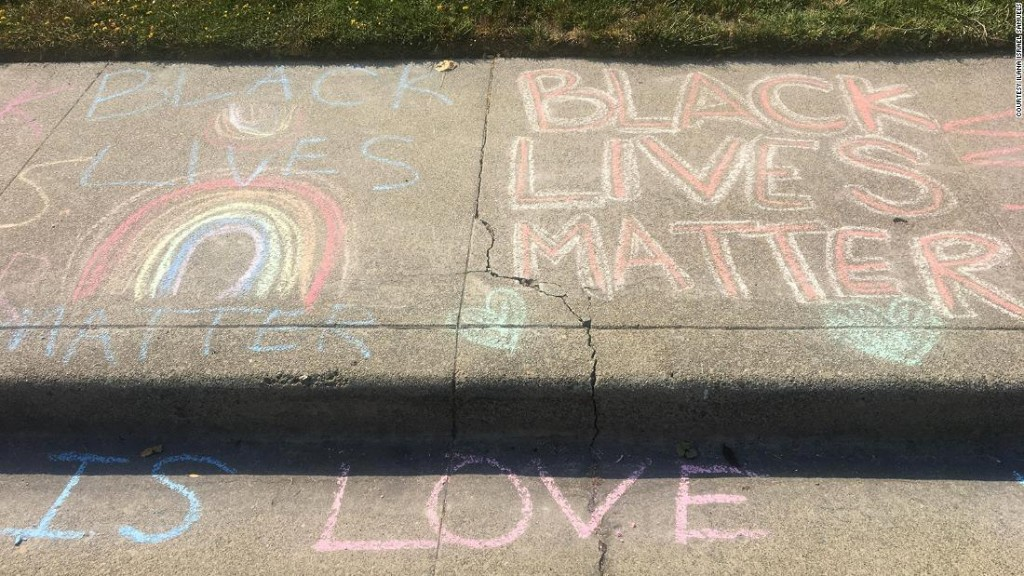 After a White man repeatedly erased girl's 'Black Lives Matter' chalk drawing in front of her home, neighbors stepped in to show support