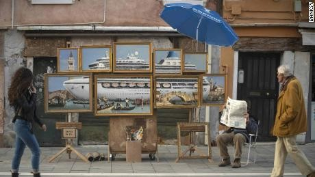 Banksy crashes Venice Biennale with street stall