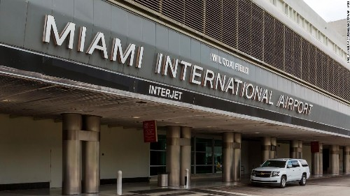 Four flight attendants were arrested in Miami's airport after bringing in thousands in cash, police say
