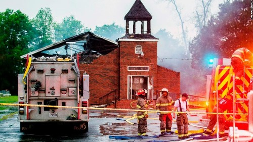 A suspect is in custody in connection with fires at three black churches in Louisiana, sources say