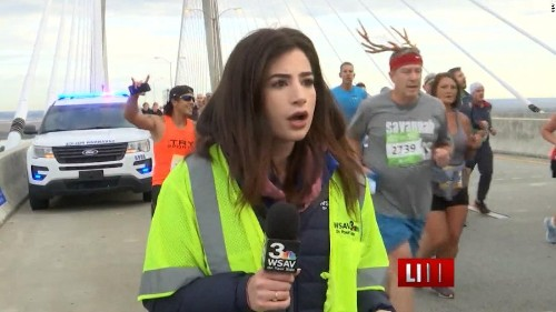 A runner who smacked a reporter's backside on air now faces charges