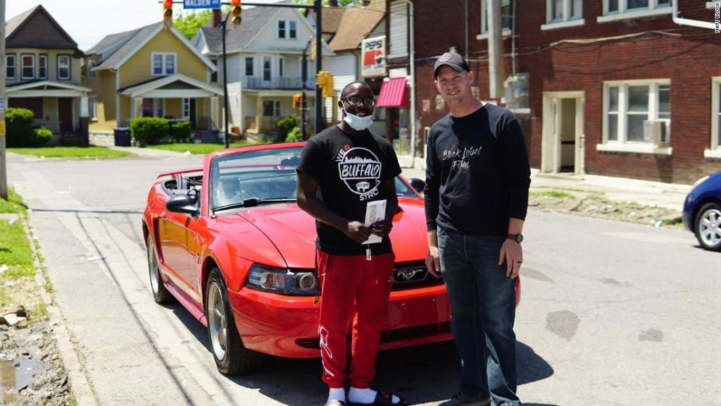 A teen who spent 10 hours cleaning up after a protest is rewarded with a car and a college scholarship