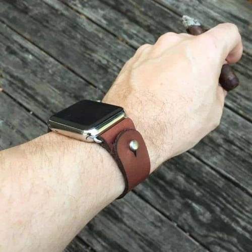 This leather, button-stud Apple Watch band will fit any wrist size