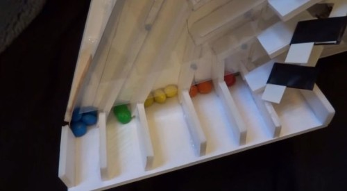 This machine uses an iPhone to sort M&M's by color
