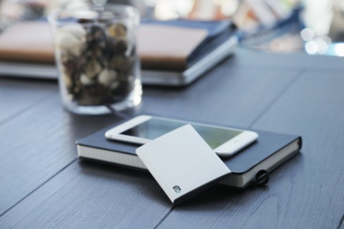 SIM card gadget lets you leave the second iPhone at home