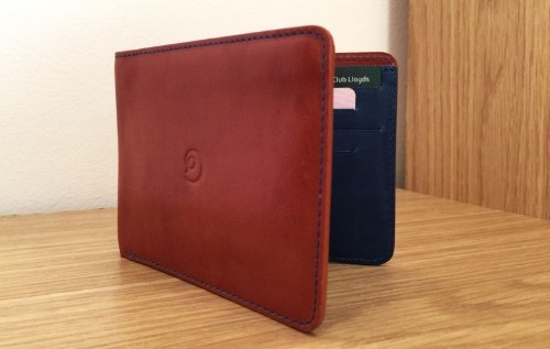 Slim Wallet is a spacious leather billfold that eliminates the pocket bulge